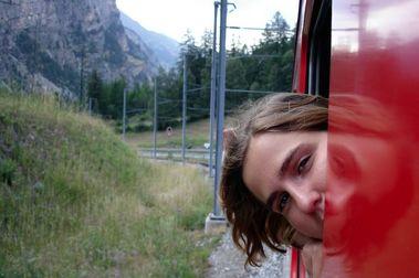 Viajando por Suiza en tren, bus postal y en barco...